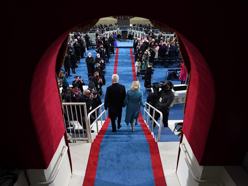 President Biden and wife Jill Biden descend the steps minutes before he officials became the 46th presidentEPA