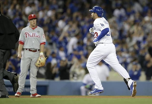 Los Angeles Dodgers' Adrian Gonzalez, right, rounds the bases after hitting a home run as Philadelphia Phillies third baseman Cody Asche watches during the seventh inning of a baseball game on Thursday, April 24, 2014, in Los Angeles. (AP Photo/Jae C. Hong)