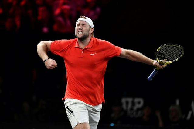 Jack Sock has wins in both singles and doubles for Team World in Geneva (AFP Photo/Fabrice COFFRINI)