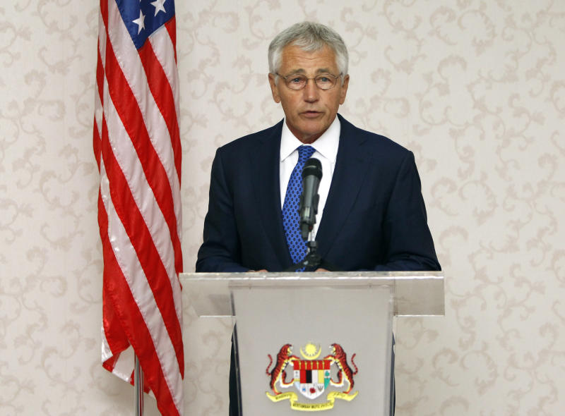 U.S. Defense Secretary Chuck Hagel speaks during a joint press conference with Malaysian Defense Minister Hishammuddin Hussein in Kuala Lumpur, Malaysia, Sunday, Aug. 25, 2013. Hagel is on a three-day visit to Malaysia. Hagel said Sunday the Obama administration is still weighing the question of whether to use military force in Syria in response to a purported chemical weapons attack. (AP Photo/Lai Seng Sin)