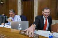 Sen. Joe Manchin, D-W.Va., left, chair of the Senate Energy and Natural Resources Committee, is joined by Sen. John Barrasso, R-Wyo., the ranking member, at the Capitol in Washington, Thursday, Aug. 5, 2021. Lawmakers continue to work today to advance the $1 trillion bipartisan bill which includes new expenditures on roads, bridges, water pipes broadband and other projects, plus cyber security. (AP Photo/J. Scott Applewhite)