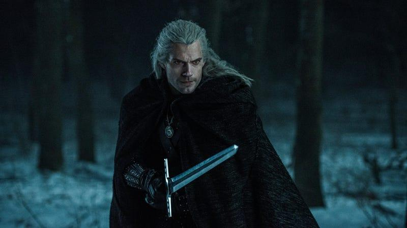 Henry Cavill, having long hair and a sword in Netflix's The Witcher.