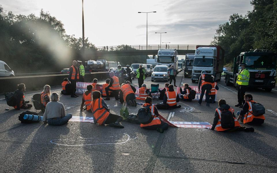 Protestors from Insulate Britain block the M25 motorway near Cobham in Surrey on September 21 - Guy Smallman/Getty Images