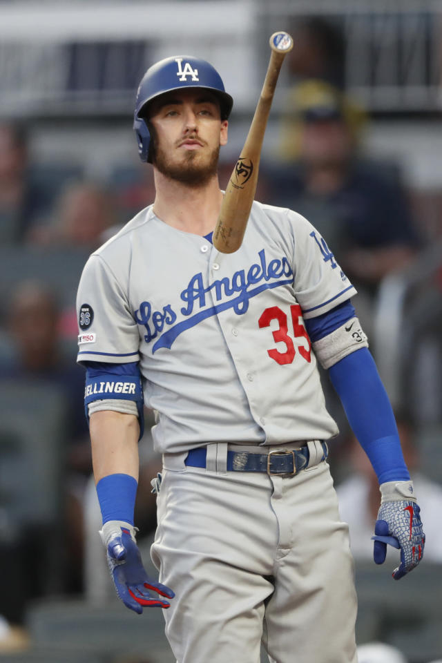 Los Angeles Dodgers' Cody Bellinger flips his bat after swinging and missing while batting in the second inning of a baseball game against the Atlanta Braves, Saturday, Aug. 17, 2019, in Atlanta. (AP Photo/John Bazemore)