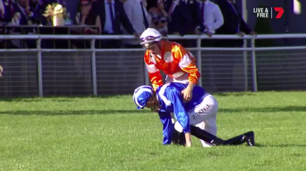 A jockey is helped up. Pic: Ch 7