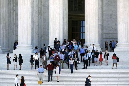 Court observers and attorneys depart after decisions were handed down on the last day of the term at the U.S. Supreme Court building in Washington June 29, 2015. REUTERS/Jonathan Ernst