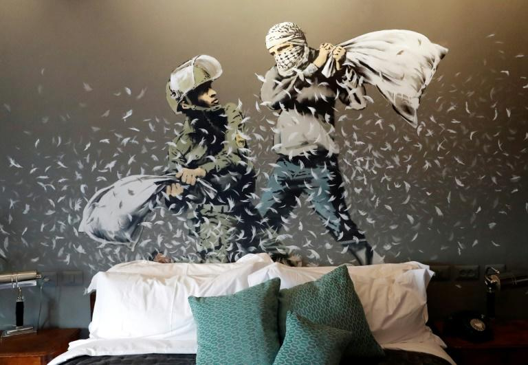 An Israeli soldier and Palestinian protester fight with pillows in one room of British street artist Banky's hotel in Bethlehem