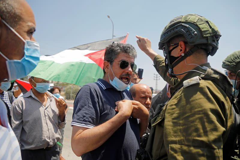 Palestinians protest against Jewish settlements and Israel's plan to annex parts of West Bank