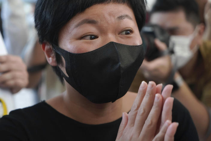 Hong Kong journalist Choy Yuk-ling, also known as Bao Choy, arrives a court in Hong Kong Thursday, April 22, 2021. Choy appeared in court on Thursday for verdict on charges of making false statements while obtaining information from a vehicle database. Choy, a producer at public broadcaster Radio Television Hong Kong, was arrested in Nov 2020. She was involved in the production of an investigative documentary into the behavior of Hong Kong police during 2019 anti-government protests, after the force was accused of not intervening during a violent clash between protesters and a mob of men in a subway station. (AP Photo/Kin Cheung)