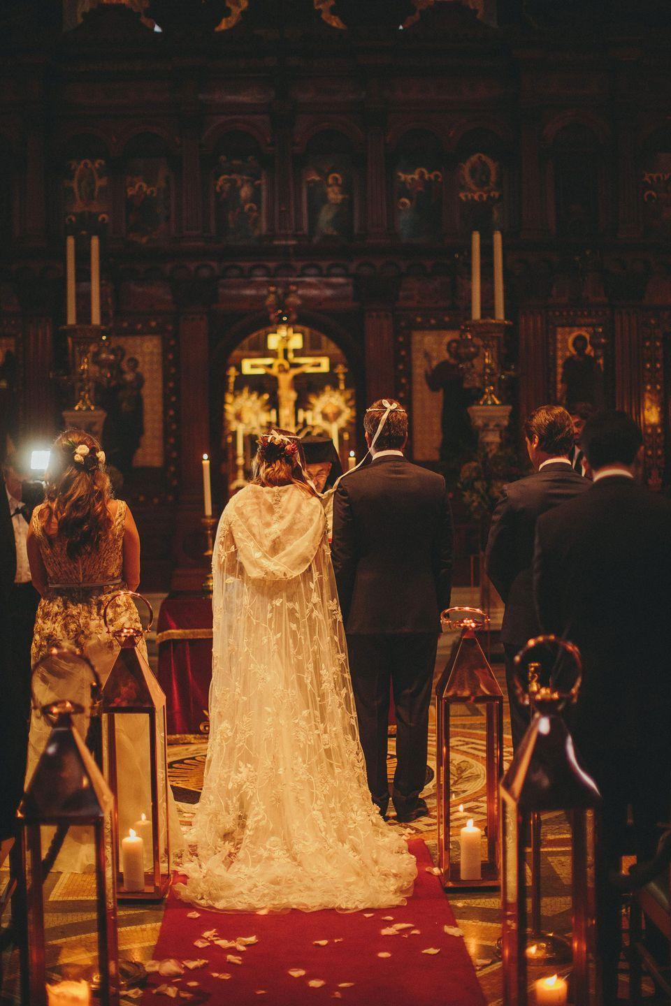 <p><strong>Wedding dress and cape:</strong> Bespoke design by Emma Victoria Payne </p><p><strong>Shoes:</strong> Jimmy Choo</p><p><strong>Earrings:</strong> Vintage (from her grandmother)</p>