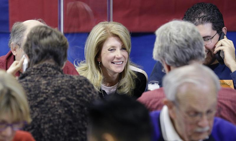 Texas Sen. Wendy Davis, D-Fort Worth, visits with volunteers manning a call center at her campaign headquarters, Tuesday, March 4, 2014, in Fort Worth, Texas. Texas is holding the nation's first primary election Tuesday with a political free-for-all in Republican races that could push the state further right, though Democrats are calling it the next big electoral battleground with Davis running for governor. (AP Photo/LM Otero)