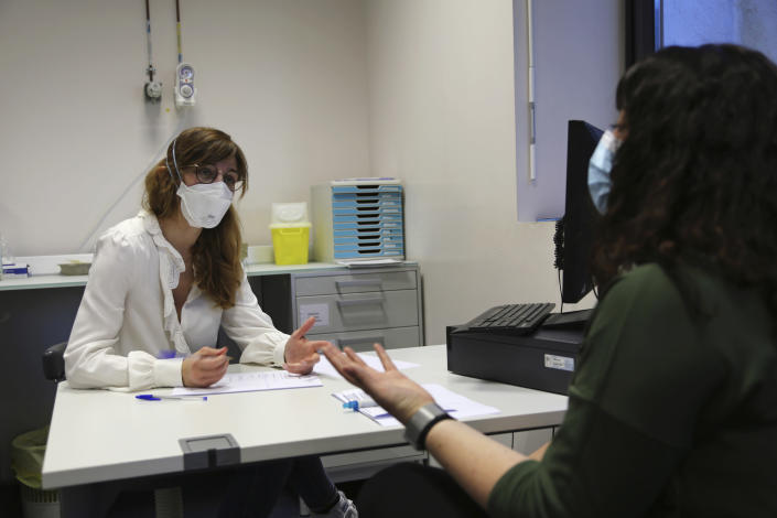 Dr. Louise-Emilie Dumas, a psychiatrist, talks with patient Gabriella Forgione during tests in a hospital in Nice, southern France, Monday, Feb. 8, 2021, to help determine why she has been unable to smell or taste since she contracted COVID-19 in November 2020. A year into the coronavirus pandemic, doctors and researchers are still striving to better understand and treat the accompanying epidemic of COVID-19-related anosmia — loss of smell — draining much of the joy of life from an increasing number of sensorially frustrated longer-term sufferers like Forgione. (AP Photo/John Leicester)