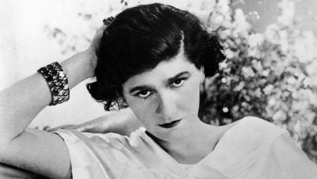Chanel photographed in 1920. She was known for her simplicity and clean lines in her fashion. Photo via The Conversation/Wikimedia Commons