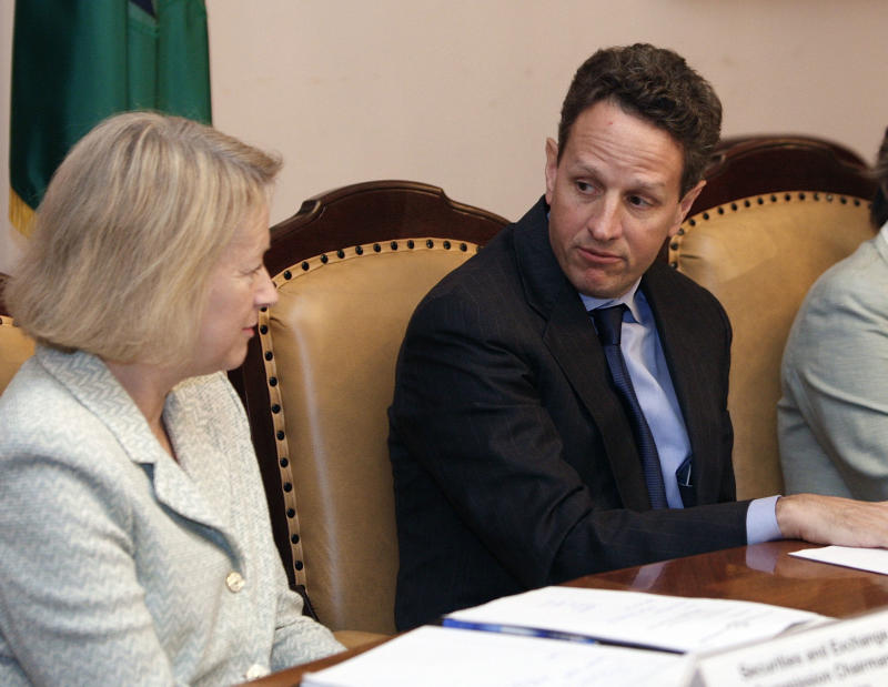 FILE-In this Thursday, June 25, 2009, file photo Treasury Secretary Timothy Geithner, right,  and Securities and Exchange Commission (SEC) Mary Schapiro, left,take part in a meeting of the President's Working Group on Financial Markets, at the Treasury  Department in Washington. Geithner is putting pressure on the Securities and Exchange Commission to overhaul its rules for money-market mutual funds. Geithner sent a letter Thursday, Sept. 27, 2012, to members of the Financial Stability Oversight Council seeking their help in pressuring the SEC to change its rules. (AP Photo/Ron Edmonds, File)