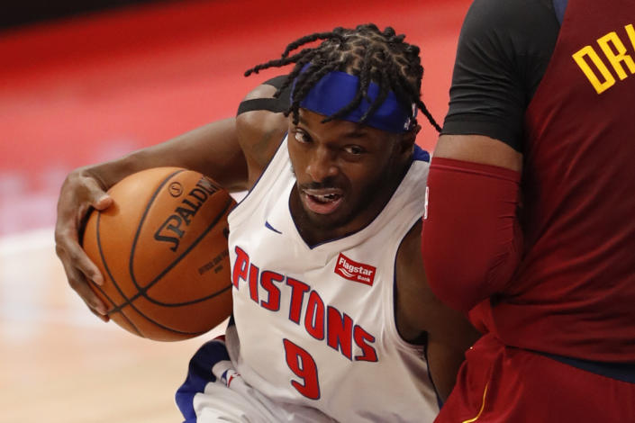 Dec 26, 2020; Detroit, Michigan, USA; Detroit Pistons forward Jerami Grant (9) gets called for a charging foul against Cleveland Cavaliers center Andre Drummond (3) during the second quarter at Little Caesars Arena. Mandatory Credit: Raj Mehta-USA TODAY Sports