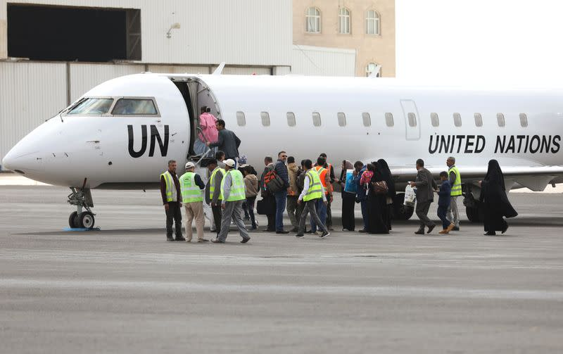 People board a United Nations plane which will carry them to Amman, Jordan in the first flight of a medical air bridge from Sanaa airport in Sanaa, Yemen
