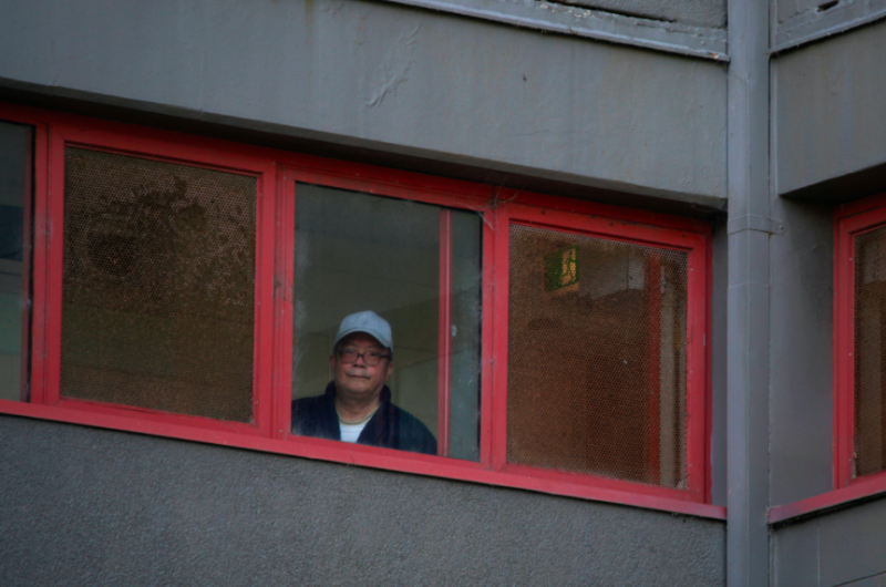 A resident looks out of his window as authorities in Melbourne keep people inside during lockdown. (Reuters)