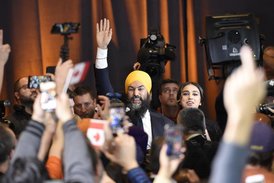 NDP leader Jagmeet Singh and his wife Gurkiran Kaur make their way to the stage at NDP election headquarters in Burnaby, B.C. on Monday, Oct. 21, 2019. THE CANADIAN PRESS/Nathan Denette