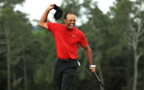 <span>Woods celebrates his victory </span> <span>Credit: Getty Images </span>