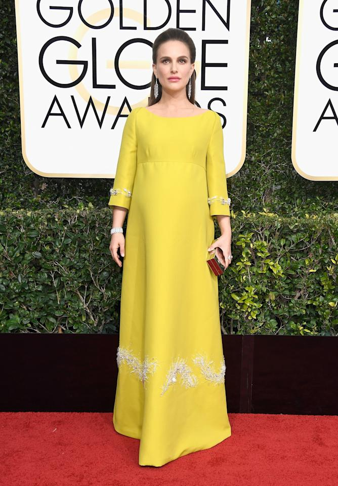 <p>Natalie wore the most expensive look of the night, pairing her yellow Prada maternity gown with over $200,000 worth of diamonds. Guaranteed a security guard wasn't too far behind. <i>[Photo: Getty]</i> </p>