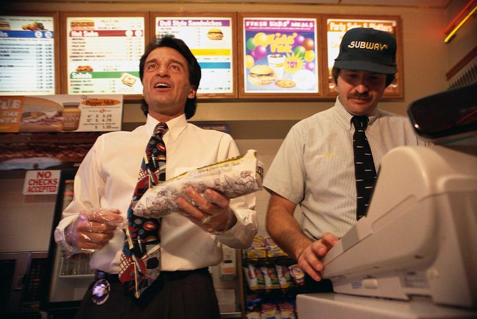 <p>While many people might not recognize Fred DeLuca on the left, he's the founder of Subway and took a visit to work at an Anaheim Subway location in 1997.</p>
