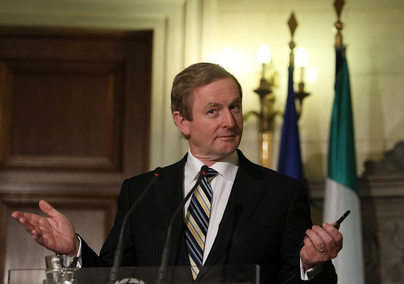 """Irish Prime Minister Enda Kenny attends a news conference with his Greek counterpart Antonis Samaras, unseen, after their meeting at Maximos Mansion in Athens, Thursday, May 23, 2013. Samaras said that Greece would follow the """"same successful model"""" as Ireland both of the EU presidency and to exit the crisis. Ireland's EU presidency will finish in the end of June. Greece is scheduled to take over the EU's rotating six-month presidency in January 2014. (AP Photo/Thanassis Stavrakis)"""