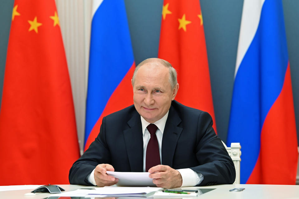 FILE - In this June 28, 2021, file photo, Russian President Vladimir Putin talks with Chinese President Xi Jinping via video conference in Moscow, Russia. U.S. President Joe Biden, his Chinese counterpart Xi Jinping, Japanese Prime Minister Yoshihide Suga and Russian President Vladimir Putin are among Pacific Rim leaders gathering for a virtual meeting on Friday, July 16, 2021, to discuss strategies to help economies rebound from a resurgent COVID-19 pandemic. (Alexei Nikolsky, Sputnik, Kremlin Pool Photo via AP, File)