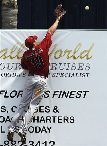 Houston Astros right fielder Brian Bogusevic cannot reach Detroit Tigers' Jhonny Peralta's solo home run in the third inning during a spring training baseball game in Lakeland, Fla., Sunday, April 1, 2012. (AP Photo/Paul Sancya)