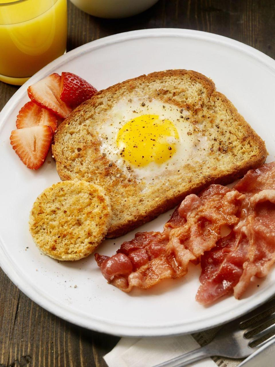 """<p>This hole-in-one beauty begins with a thick slice of buttered brioche bread. The freshest eggs will have centered, golden yolks and the best flavor. Pair with bacon or roasted tomatoes. </p><p><strong><a href=""""https://www.countryliving.com/food-drinks/recipes/a843/egg-in-the-hole-19/"""" rel=""""nofollow noopener"""" target=""""_blank"""" data-ylk=""""slk:Get the recipe"""" class=""""link rapid-noclick-resp"""">Get the recipe</a>.</strong><br></p>"""