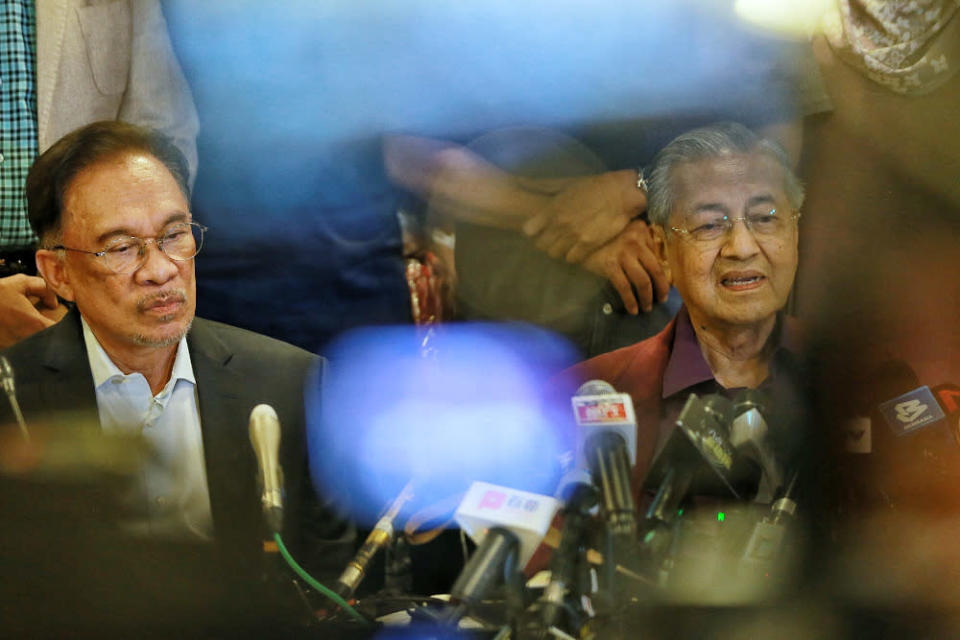 Datuk Seri Anwar Ibrahim and Tun Dr Mahathir Mohamad are seen during a press conference after the Pakatan Harapan President Council Meeting at Yayasan Perdana Foundation in this file picture taken on February 21, 2020. — Picture by Ahmad Zamzahuri