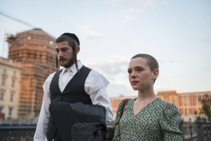 "This image released by Netflix shows Amit Rahav, left, and Shira Haas in a scene from ""Unorthodox."" The series was nominated for a Golden Globe for best TV movie or limited series. (Anika Molnar/Netflix via AP)"