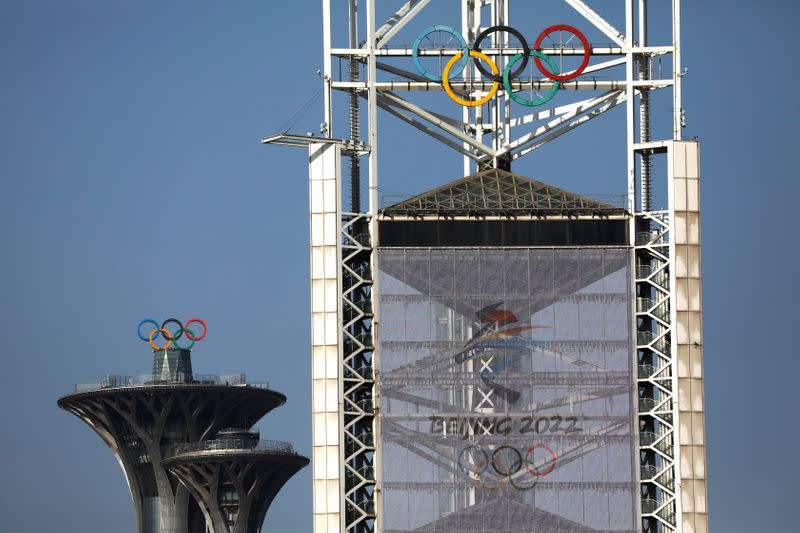 Olympic rings and a sign of 2022 Winter Olympic Games, are seen at the Beijing Olympic Green in Beijing