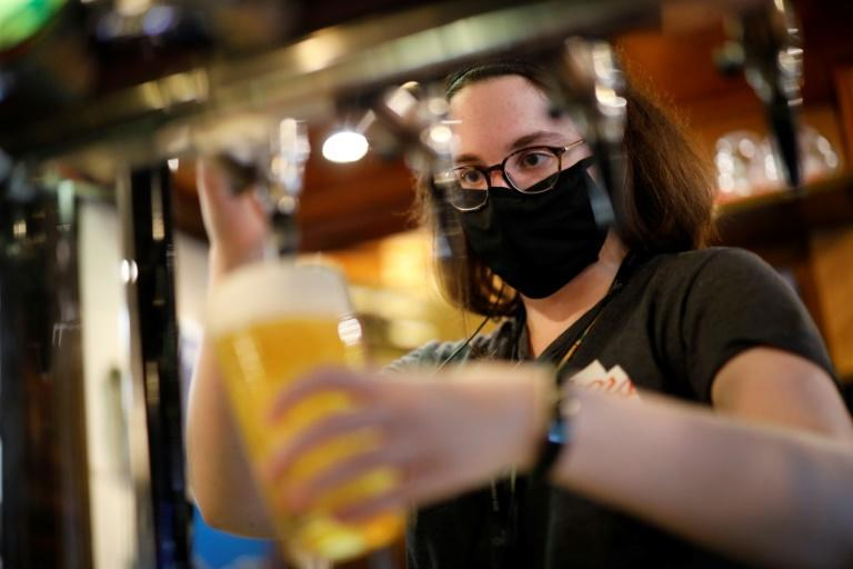 UK pub chain Wetherspoon has said that it has run out of some top-selling lagers (AFP/Tolga Akmen)