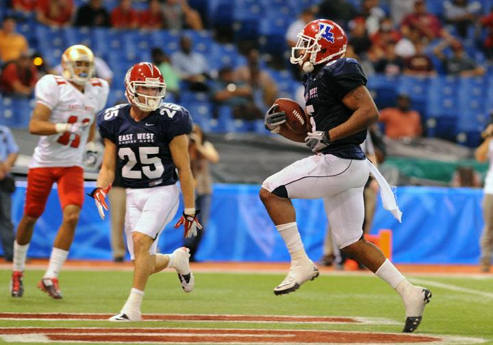 ST. PETERSBURG, FL - JANUARY 21: Running back Lennon Creer #5 of the Louisana Tech Biulldogs runs for the game-winning touchdown in the fourth quarter during the 87th annual East-West Shrine game January 21, 2012 at Tropicana Field in St. Petersburg, Florida. (Photo by Al Messerschmidt/Getty Images)