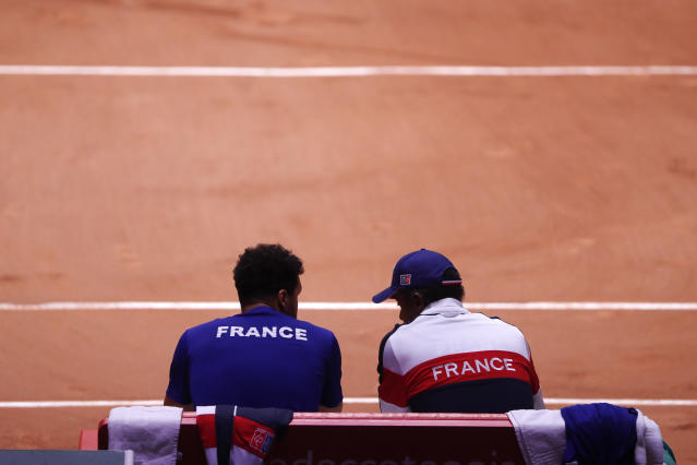 France's team captain Yannick Noah, right, speaks France's Jo-Wilfried Tsonga during a break as Tsonga plays Croatia's Marin Cilic during the Davis Cup final between France and Croatia, Friday, Nov. 23, 2018 in Lille, northern France. (AP Photo/Thibault Camus)