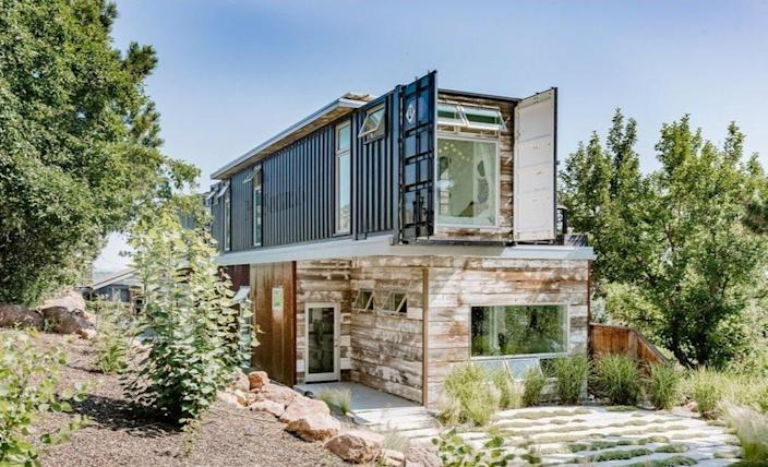 Exterior side shot of a gorgeous upcycled shipping container home outside Boulder, Colorado.