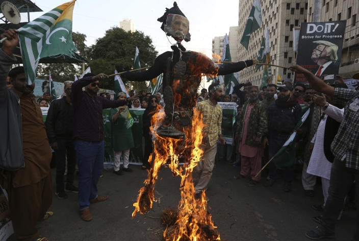 FILE - In this Feb. 5, 2020, file photo, protesters burn an effigy of Indian prime minister during a rally to express solidarity with Indian Kashmiris struggling for their independence, in Karachi, Pakistan. India's leaders are anxiously watching the Taliban takeover in Afghanistan, fearing that it will benefit their bitter rival Pakistan and feed a long-simmering insurgency in the disputed region of Kashmir, where militants already have a foothold. (AP Photo/Fareed Khan, File)
