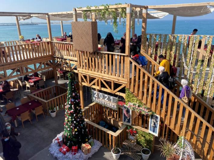 """A Christmas tree is seen at the """"Maldive Gaza"""" cafe on a beach in Gaza City"""