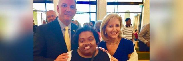 Louisiana Governer John Bel Edwards and his wife Donna with disability advocate April Dunn (center)