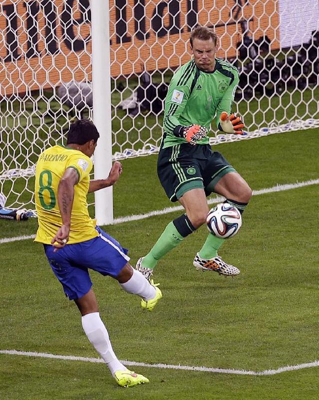 Germany's goalkeeper Manuel Neuer saves a shot by Brazil's Paulinho during the World Cup semifinal soccer match between Brazil and Germany at the Mineirao Stadium in Belo Horizonte, Brazil, Tuesday, July 8, 2014. (AP Photo/Themba Hadebe)