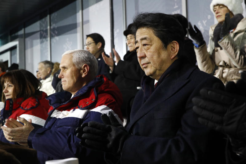 Japanese Prime Minister Shinzo Abe, right, sits alongside U.S. Vice President Mike Pence, center, and second lady Karen Pence at the opening ceremony of the 2018 Winter Olympics in Pyeongchang, South Korea, Friday, Feb. 9, 2018. (AP Photo/Patrick Semansky, Pool)
