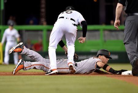 Jun 12, 2018; Miami, FL, USA; San Francisco Giants left fielder Gorkys Hernandez (7) is tagged out at second base by Miami Marlins shortstop JT Riddle (10) fifth inning at Marlins Park. Mandatory Credit: Steve Mitchell-USA TODAY Sports