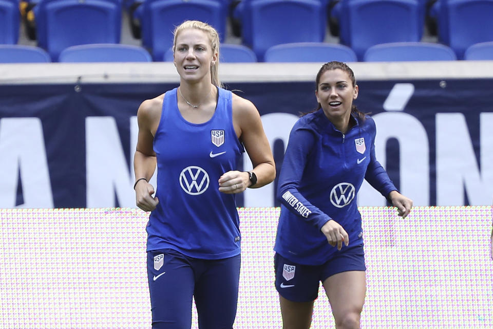 United States midfielder Julie Ertz, left, and United States forward Alex Morgan warm up during a soccer workout at Red Bull Arena, Saturday, May 25, 2019, in Harrison, N.J. The U.S. will play against Mexico in an international soccer friendly on Sunday. (AP Photo/Steve Luciano)
