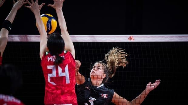 A kill attempt by Canada outside hitter Kiera van Ryk, right, is met by two Japanese players during Volleyball Nations League play on Monday in Rimini, Italy. Japan won three sets to zero to improve its record to 6-2 while Canada fell to 2-6. (Submitted by volleyballworld.com - image credit)