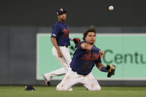 Minnesota Twins first baseman Willians Astudillo throws out Washington Nationals' Juan Soto on a grounder in the eighth inning of a baseball game Wednesday, Sept. 11, 2019, in Minneapolis. The Nationals won 6-2. (AP Photo/Jim Mone)