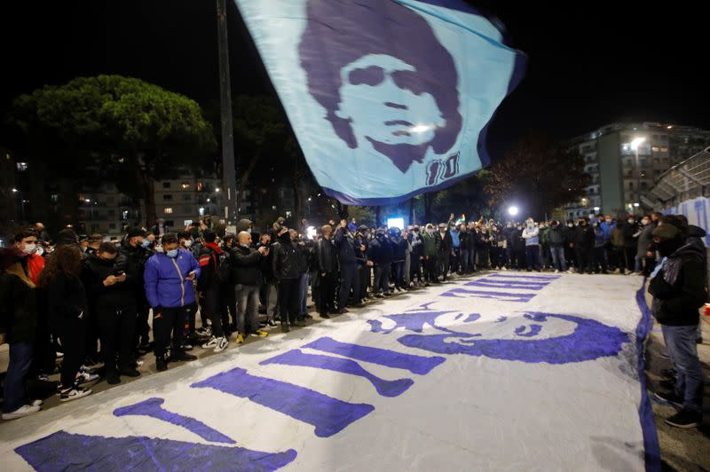 People gather to mourn the death of Argentine soccer legend Diego Maradona outside San Paolo stadium in Naples
