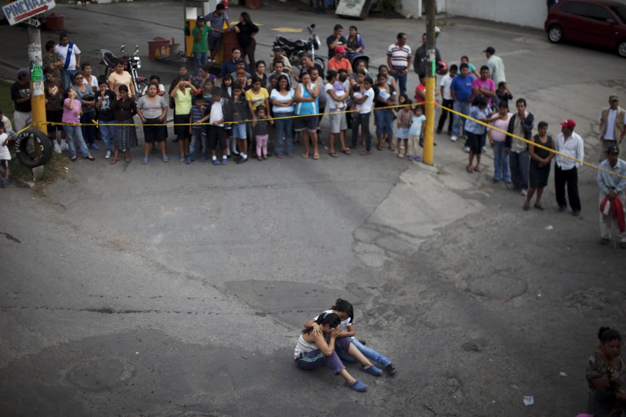 In this picture taken Tuesday Feb. 7, 2012, relatives mourn the death of a relative shot to death in Guatemala City. President Otto Pérez Molina will meet on Monday with El Salvador's President Mauricio Funes to address issues related to regional security and how to coordinate their fight against organized crime. Perez has blamed the drug cartels for the high levels of violence in his country of 13 million overrun by gangs and the Mexican cartels, with a rate of 41 homicides per 100,000 inhabitants, nearly three times that of neighboring Mexico. (AP Photo/Rodrigo Abd)