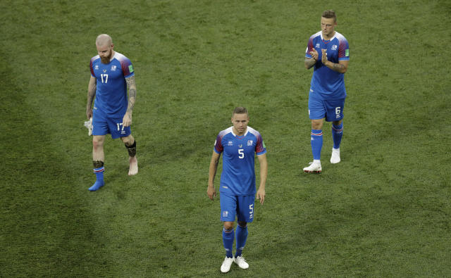 From left: Iceland's Aron Gunnarsson, Iceland's Sverrir Ingason and Iceland's Ragnar Sigurdsson greet supporters at the end of the group D match between Nigeria and Iceland at the 2018 soccer World Cup in the Volgograd Arena in Volgograd, Russia, Friday, June 22, 2018. (AP Photo/Themba Hadebe)