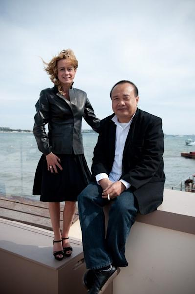 French actress Sandrine Bonnaire (L) and Cambodian-French director Rithy Panh (R) pose on May 14, 2010 in Cannes during the 63rd Cannes Film Festival. A documentary on relatives wiped out in the Khmer Rouge's tyrannical grip on Cambodia in the 1970s earned Panh a major prize at the 2013 Cannes Film Festival on Saturday