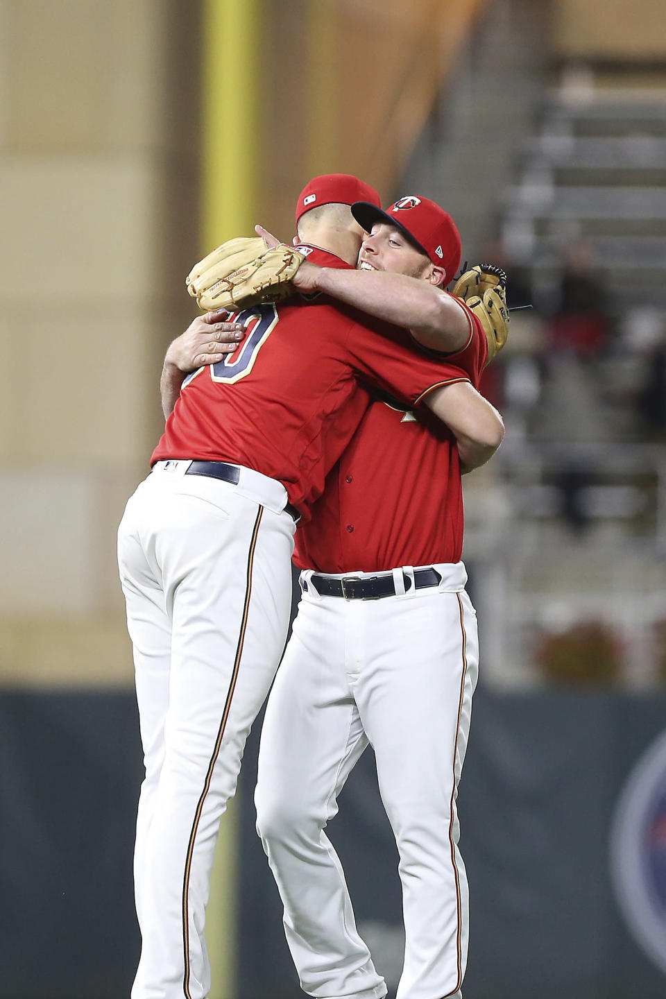Minnesota Twins pitcher Aaron Slegers, left, and teammate Chris Gimenez, right, celebrate after their win overthe Chicago White Sox in the second game of a baseball doubleheader Friday, Sept. 28, 2018, in Minneapolis. (AP Photo/Stacy Bengs)